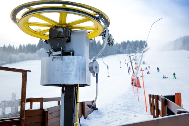 Ski chair lifts on foot of ski slope at austrian alps