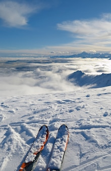 Ski on mountain top, winter landscape in the alps