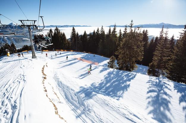 Ski resortand ski slope with  mountains panorama