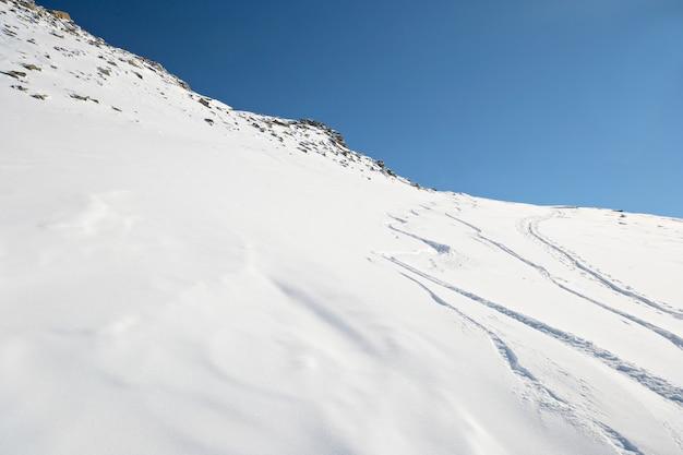 Ski tracks in powder snow winter on the alps