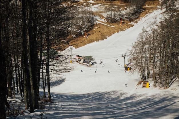 Ski tracks on snow at alpine mountain hill. skiers skiing at ski resort.