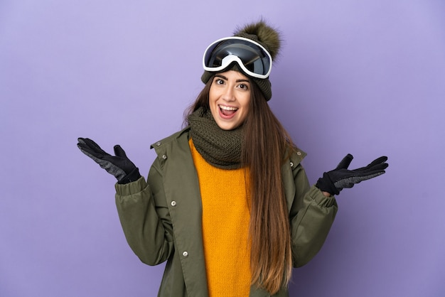 Skier caucasian girl with snowboarding glasses isolated