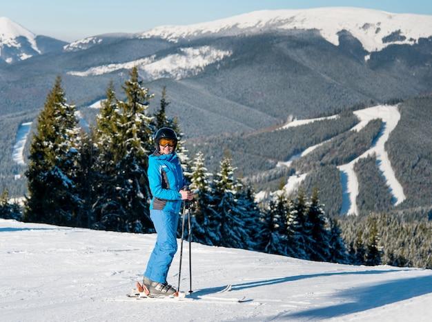 Skier skiing on slope at winter ski resort