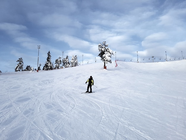 A skier slides down a mountain slope