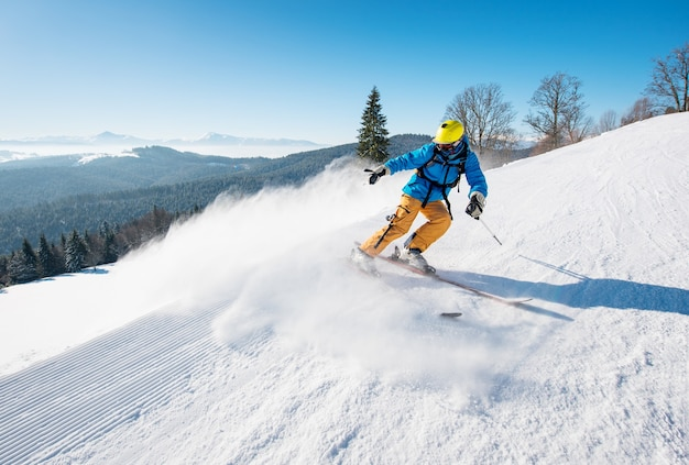 Skier on slope in mountains on winter day