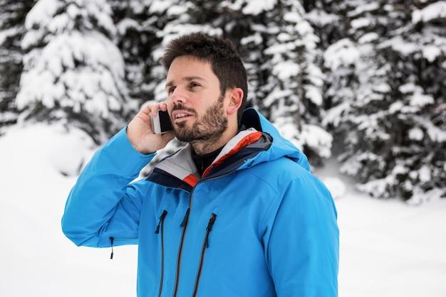 Skier talking on mobile phone