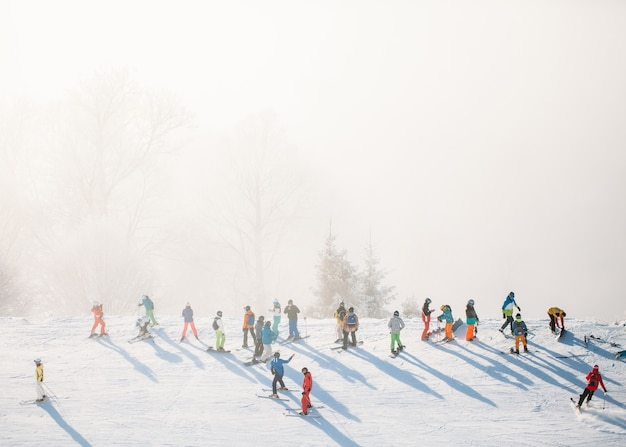 Skiing in the mountain resort with fog