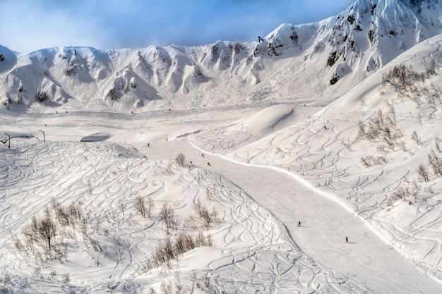 Skiing and snowboarding in the mountain ski resort of krasnaya polyana , sochi, russia.