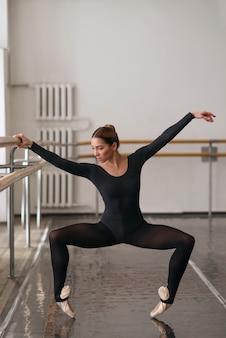 Skill ballerina posing in ballet class