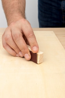 Skilled carpenter worker using his tools on wood