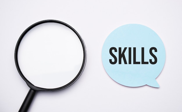 Skills, speech bubble and black magnifier isolated on the yellow background.