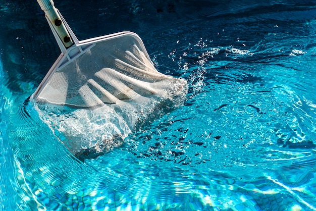 Skimmer rake in a pool.