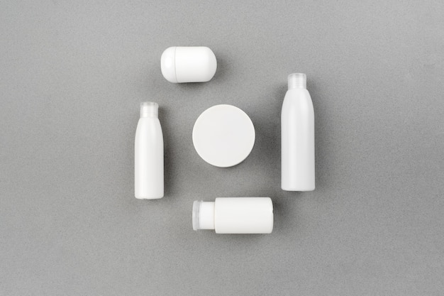 Skin and body care spa set on abstract gray background. anti aging and acne massage routine. top horizontal view copyspace.
