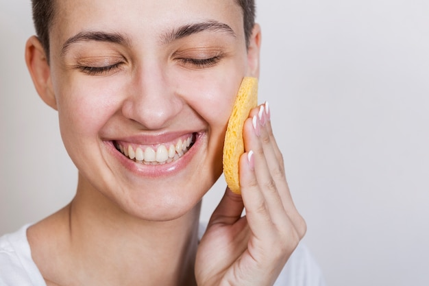 Skin care face product applying process