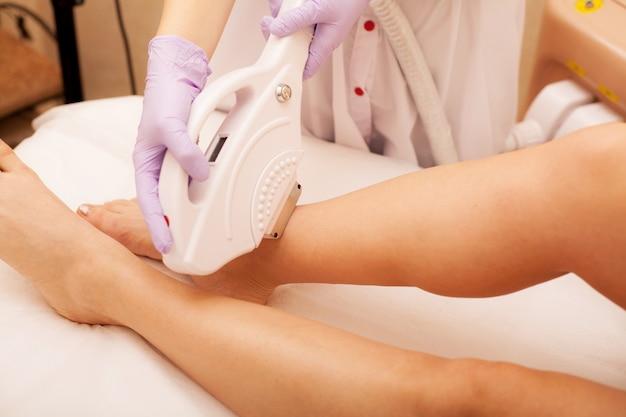 Skin care. hair removal on the legs, laser procedure at clinic.