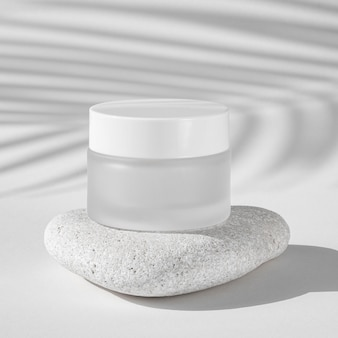 Skin care moisture recipient on a white rock