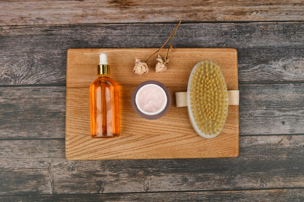 Skin care products. anti-cellulite massage brushes. top view. massage brush. on a pink space. accessories for massage.