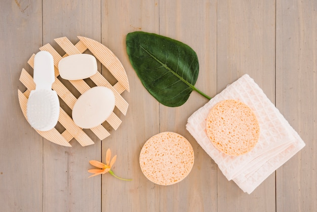 Skin care products on napkin decorated with flower and leaf