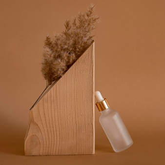 Skin oil dropper arrangement with wooden decoration