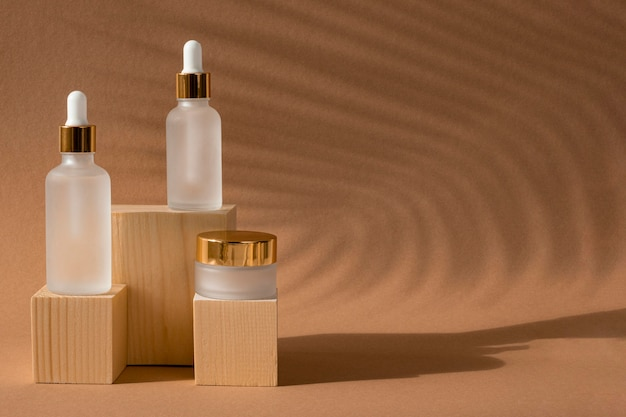Skin oil droppers and face cream recipients arrangement with copy space
