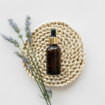 Skin oil and flowers top view