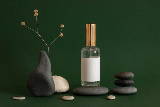 Skin product arrangement with grey and beige stones