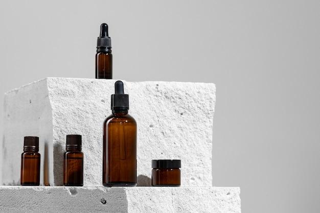 Skincare cosmetic jar on gray concrete block close up