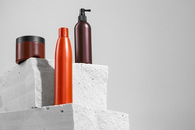 Skincare cosmetic jar on gray concrete block