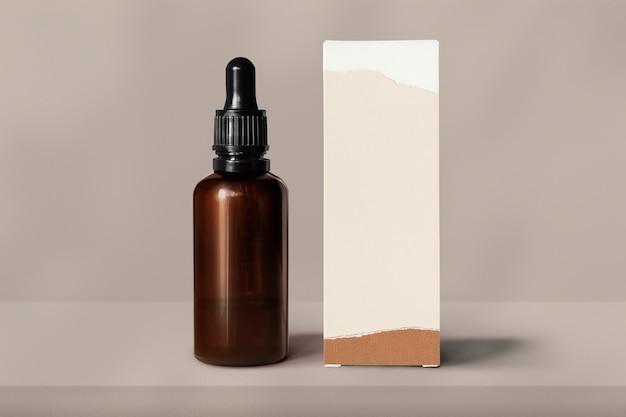 Стеклянная бутылка для ухода за кожей с коробкой для упаковки косметических продуктов