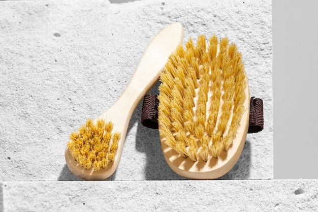 Skincare massage brush on gray concrete block close up