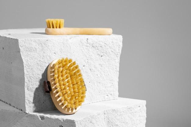 Skincare massage brush on gray concrete block