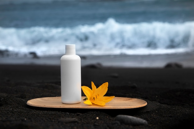 Skincare tube product on black canarian sand.