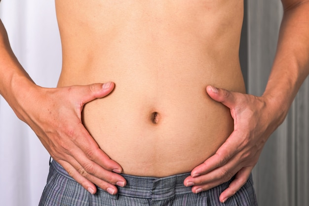 Skinny man with belly fat pulled have pulled their abdominal muscle