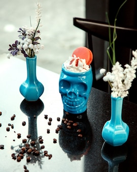 Skull cup with cream and macaroon