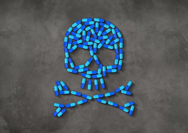 Череп из синих капсул, изолированных на темной бетонной поверхности. 3d иллюстрации