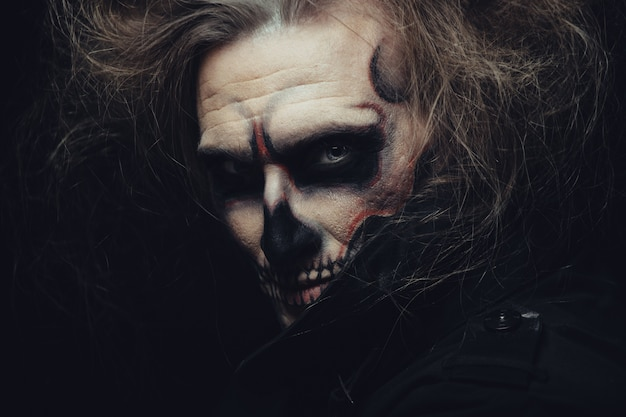 Skull makeup portrait of young man