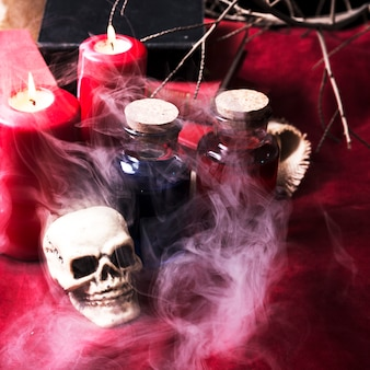 Skull and potions on smoke