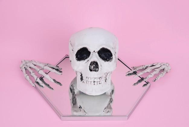 Skull on trendy pastel pink background.