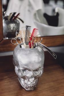 Skull with barber equipment