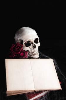 Skull with book mock-up on black background