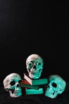 Skulls illuminated by green light
