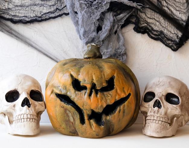 Skulls near creepy jack-o-lantern