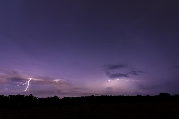 Sky background and lightning bolt at night