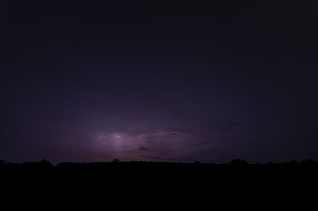 Sky background and lightning bolt at night
