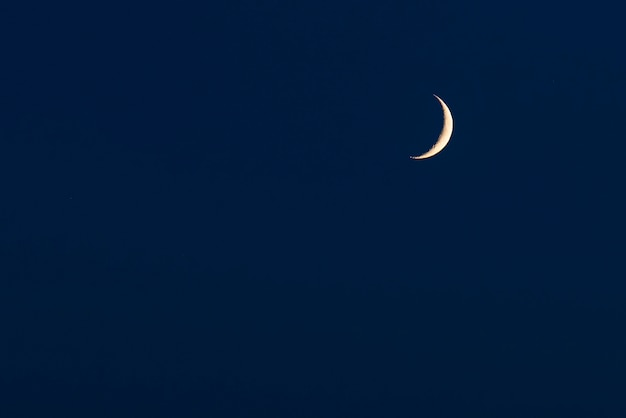 Sky background with crescent or half moon