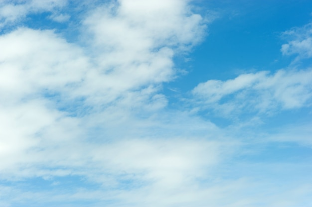 The sky and the blue clouds on a bright blue day