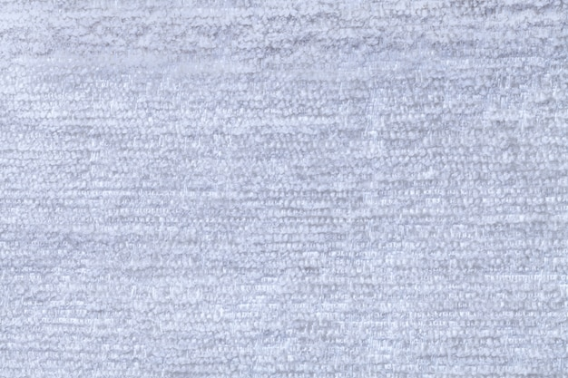 Sky blue fluffy background of soft, fleecy cloth  texture of light nappy textile, closeup