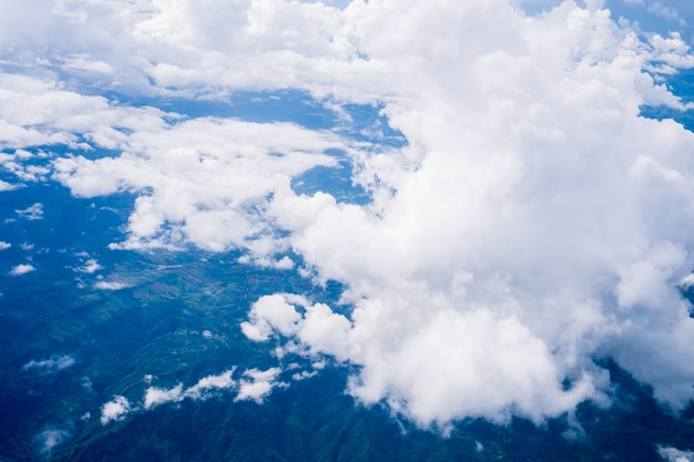 Sky clouds cape from aerial airplane shot of blue clouds.