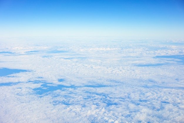Sky and clouds seen from the window of an airplane