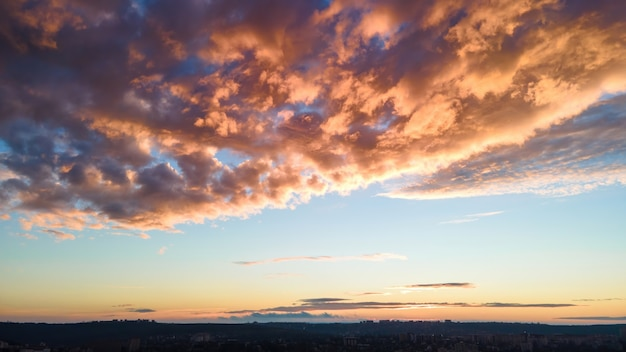 Sky covered with orange colored clouds at sunset in chisinau, moldova